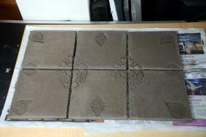 Six stoneware tiles