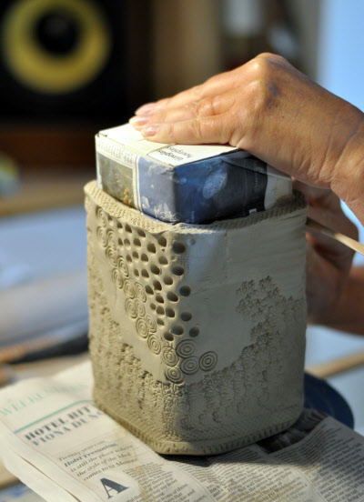 handbuilding with stoneware clay around a form