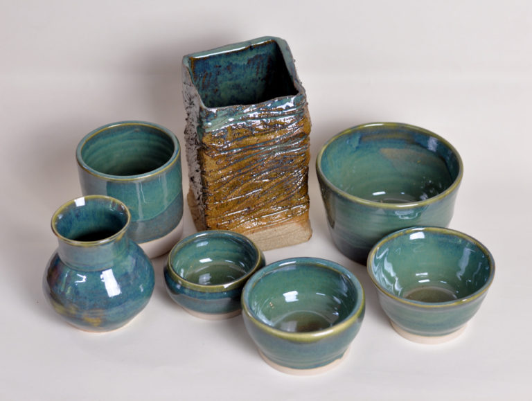 A shiny green glaze with darker green marbling. Best results obtained when cooled slowly.  Firing Range 1230-1300°C